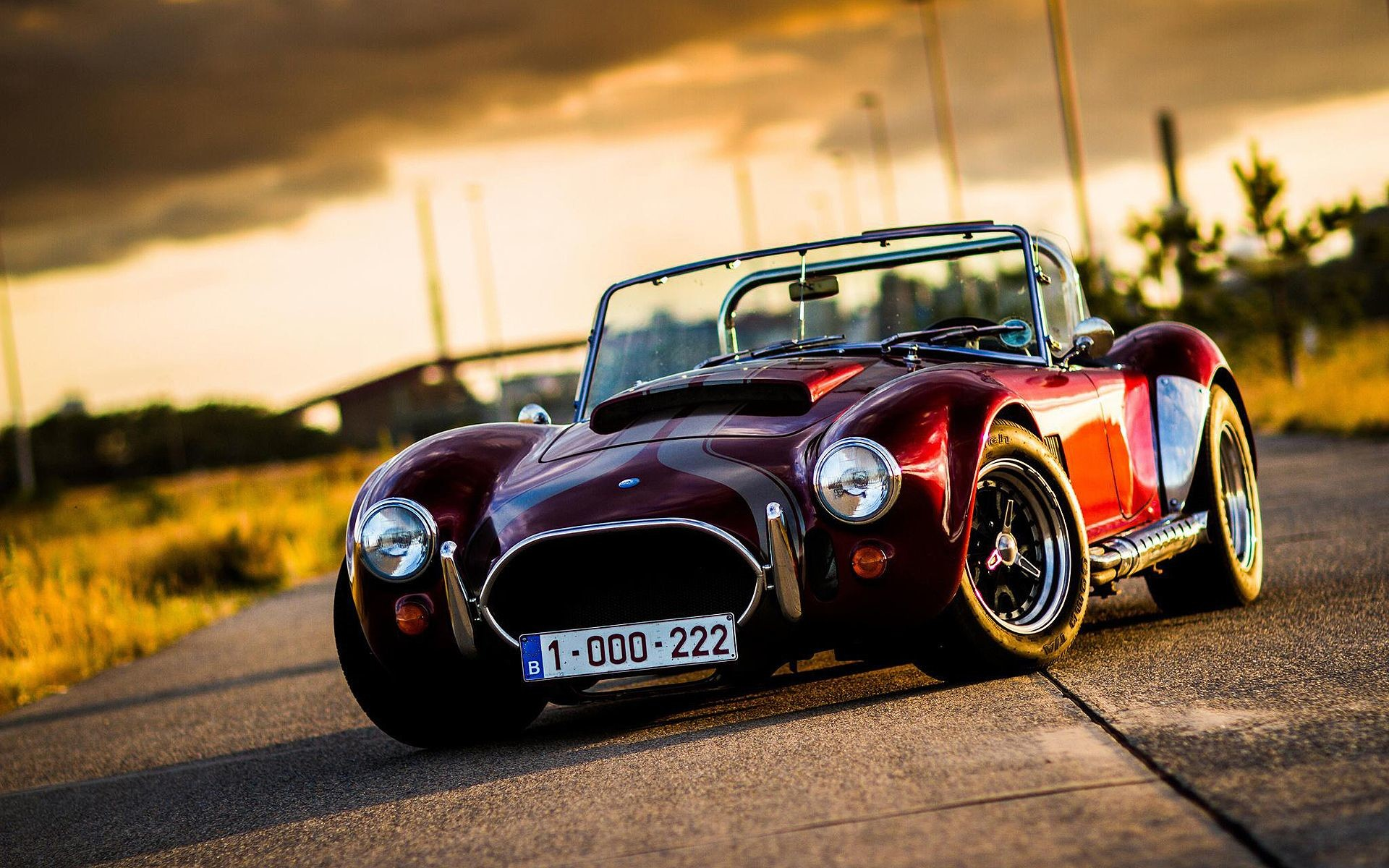 6213_Old-classic-car-small-AC-Cobra-on-the-road